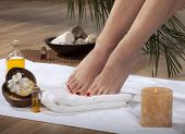 image of wet feet  - Female feet with drops of water on spa background - JPG