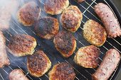 picture of meatball  - Fresh grilled sausages and meatballs closeup view