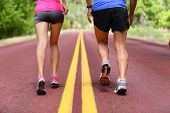 Running people. Runners jogging close up of sport fitness running shoes and legs and shorts. Athlete poster