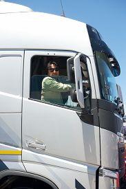 foto of truck-stop  - Big truck driver in cabin - JPG