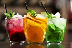 stock photo of mint-green  - Glasses of cocktails on bar background - JPG
