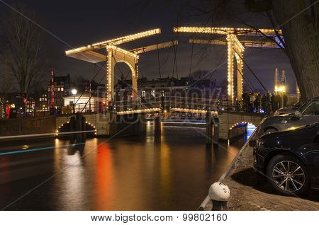 nightshot of an illuminated bridge in amsterdam netherlands