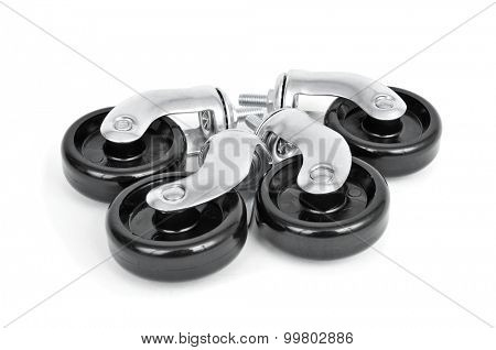 closeup of some new swivel casters on a white background