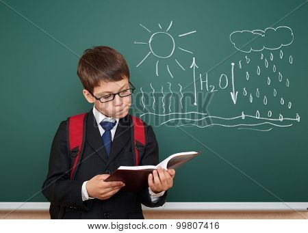 school boy read book about circulation of water