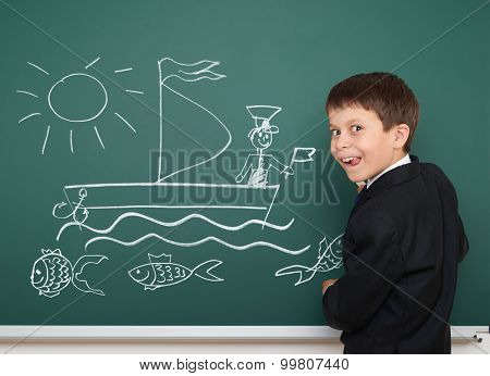 school boy draw ship board and stand back