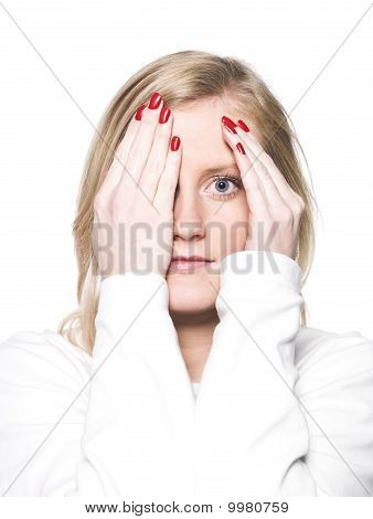 Portrait Of A Young Woman Hiding In Her Hands
