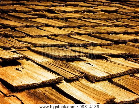 Detail of old wooden wood shingles on top of house home