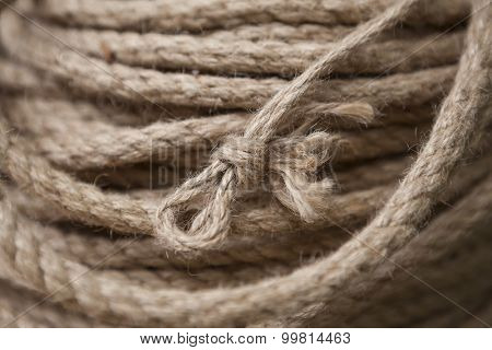 Coil of rope with marine knot loop. Roll of ship ropes as background texture