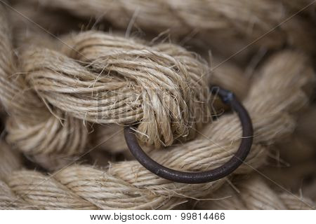 Coil of rope with a marine unit, and an iron ring