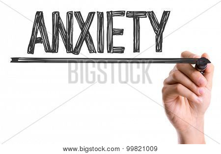 Hand with marker writing the word Anxiety