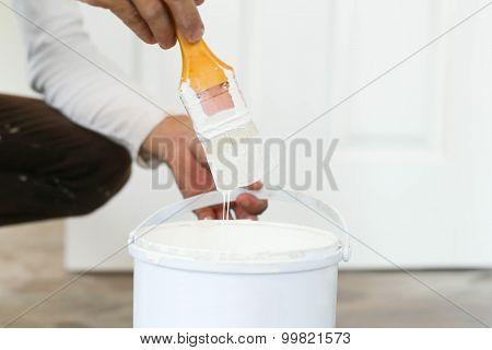 Painter Hand Holding Paint Brush