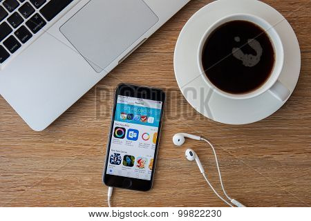 CHIANGMAITHAILAND - FEBRUARY 5 2015: Brand new Apple iPhone 5S with iTunes store application on the screen lying on a desk. iTunes is the media library for organize media files developed by Apple Inc.