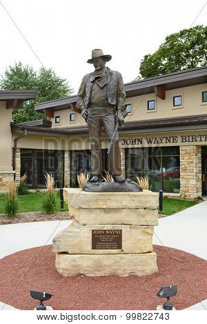 WINTERSET, IOWA - AUGUST 20, 2015: Statue of John Wayne at the John Wayne Birthplace Museum. The museum opened to the public in May of 2015.