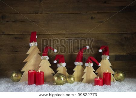 Four red burning advent candle for christmas decoration on old wooden background.