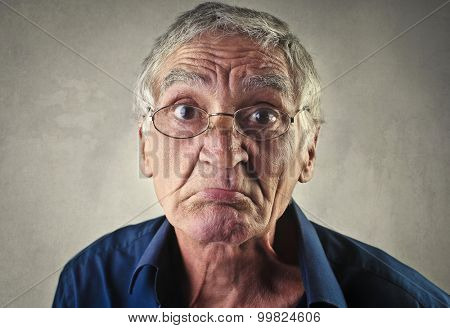 Sad elderly man