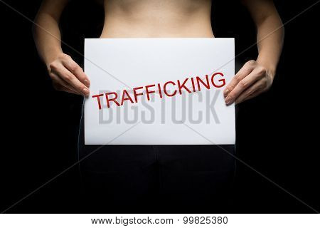 Woman Holding Paper With Word Trafficking