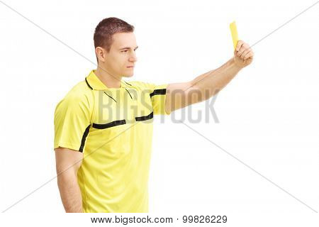 Football referee showing a yellow card isolated on white background