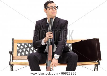 Desperate businessman ready to commit suicide isolated on white