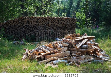 Green Yard With Woodstack.