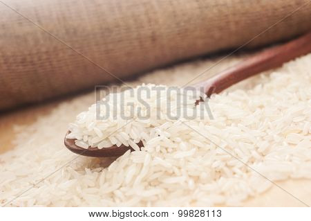Rice, White Rice In Wooden Spoon With Hemp Sack