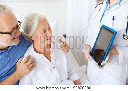 medicine, age, health care and people concept - senior woman, man and doctor with tablet pc computer at hospital ward