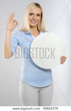 woman with board and showing okay gesture