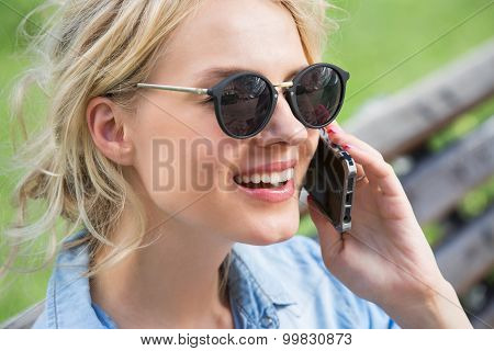Cute blonde talking on a cell phone.