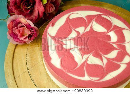 Raspberry yoghurt cheese cake on wooden table