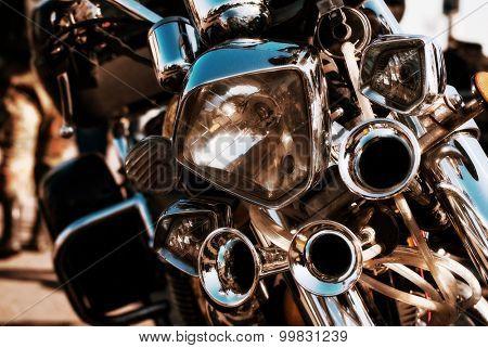 chrome headlight and horn motorbike. close-up
