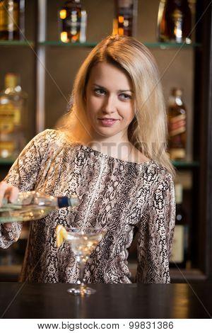 Blond Bartender Making Cocktail