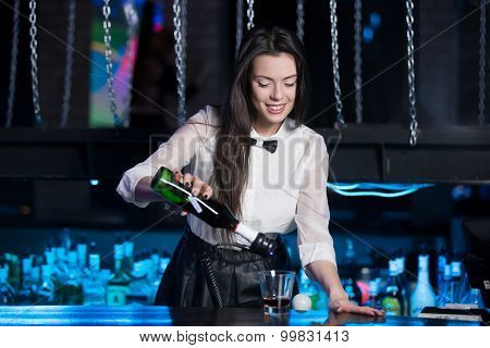 Smiling Brunette Bartender Serving Drink