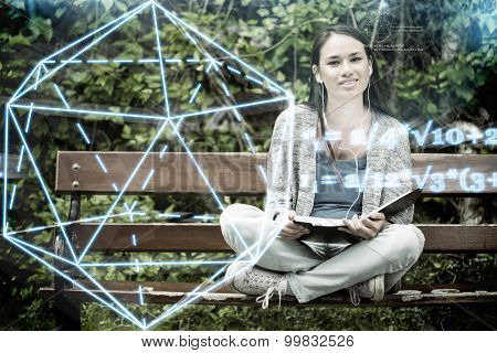 geometry problem against smiling student sitting on bench listening music with mobile phone and holding book