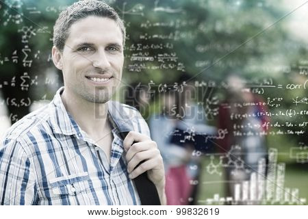 Maths equations against happy student smiling at camera outside on campus