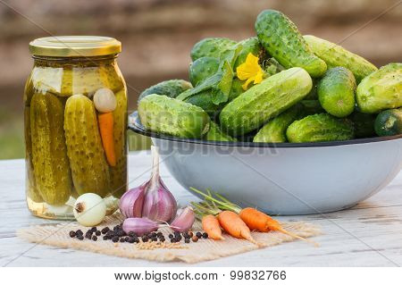 Cucumbers In Metal Bowl, Vegetables And Spices For Pickling And Jar Pickled Cucumbers