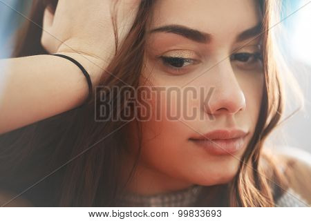 Portrait of pensive sad and thoughtful young woman