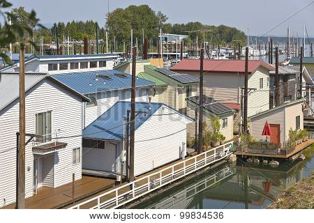 Rooftops And Floating Houses In A Marina.
