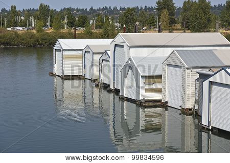 Motorboat Garages On A River Inlet Portland Oregon.
