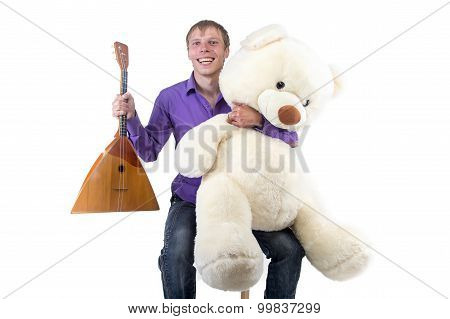 Image man with balalaika and teddy bear