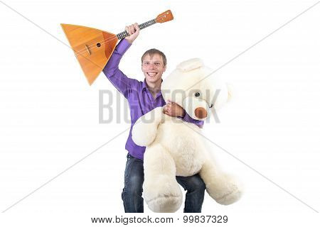 Photo smiling man with balalaika, teddy bear