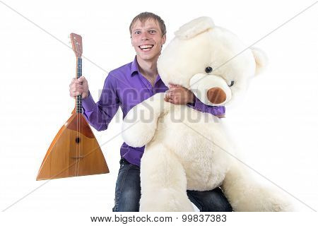 Photo man with balalaika and teddy bear
