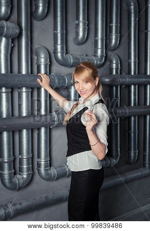 woman near pipes construction