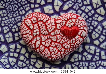 Red Speckled Heart On Purple Background.