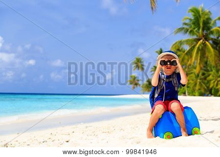 little boy travel on summer tropical beach
