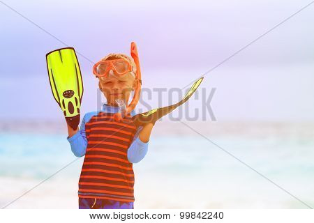 little boy snorkeling with flippers at beach