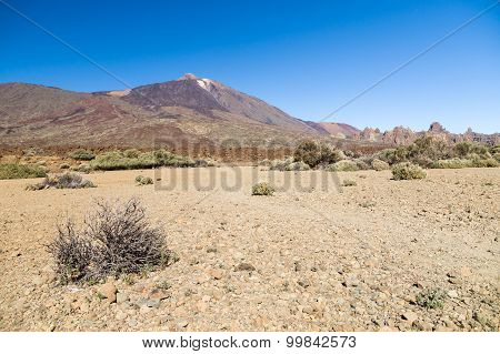 Arid And Stony Landscape Of Caldera With View On Volcano Teide