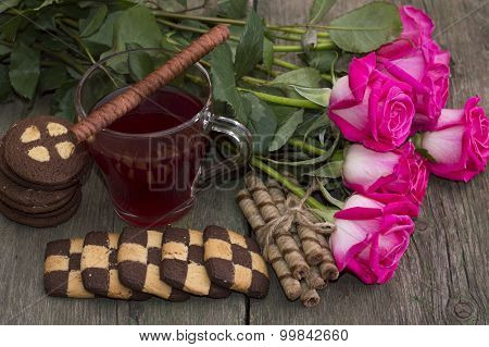 Beautiful Still Life From Roses, Cookies And Tea On A Wooden Table