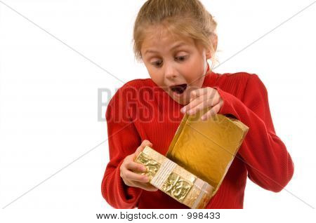 Young Girl In Red Opening Gold Christmas Present