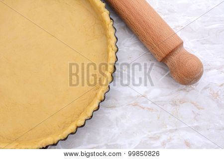 Baking Tin Lined With Pastry, Wooden Rolling Pin Beside