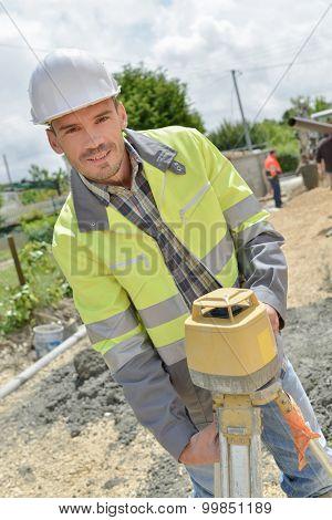 Site surveyor setting up his equipment