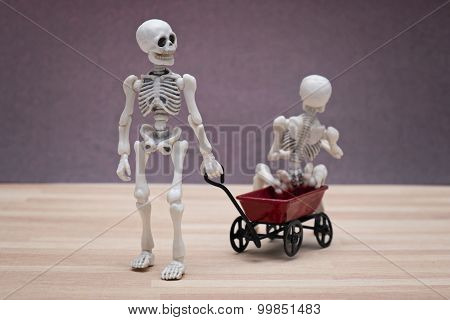 Skeletons and toy wagon